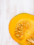 Pumpkin on wooden background Royalty Free Stock Images