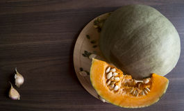 Pumpkin. On a wooden Board with seeds Stock Photo