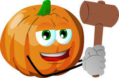 Pumpkin with a wooden hammer Royalty Free Stock Image