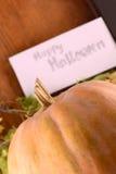 Pumpkin on wooden table, happy halloween Royalty Free Stock Photos