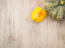 Pumpkin on a wooden table Royalty Free Stock Image