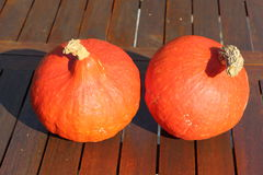 Pumpkin on a wooden table Royalty Free Stock Photo