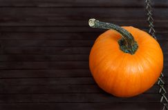 Pumpkin on wooden tray, copy space at left Royalty Free Stock Photo
