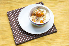 Pumpkin yogurt dessert with maple granola topping Royalty Free Stock Photo