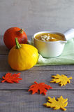 Pumpkin zucchini soup with feta cheese and pepper Stock Image