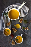 Pumpking soup. Rustic styled pumpkin soup served in cups with sage pesto and toast Stock Image