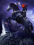 Pumpkinhead knight on the cemetery hill Royalty Free Stock Photography