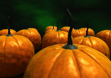 Pumpkins. View of a lot of orange pumpkins on a dark green background Stock Photography