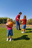 Pumpkins. Family picking pumpkins in pumpkin patch Stock Image