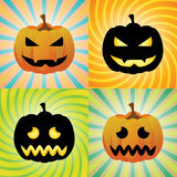 Pumpkins. With different facial expressions in orange and black silhouette on bright colored sunburst and swirl backgrounds Royalty Free Stock Photo