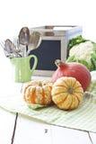 Pumpkins. Orange and yellow pumpkin on green tea towel kitchen stuff on background stock image