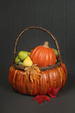 Pumpkins and Apples in Basket, Fall or Thanksgiving Theme Royalty Free Stock Photos