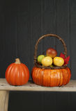 Pumpkins and Apples in Basket, Fall or Thanksgiving Theme Royalty Free Stock Images
