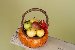 Pumpkins and Apples in Baskets on Wood Bench Royalty Free Stock Images