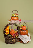 Pumpkins and Apples in Baskets on Wood Bench Royalty Free Stock Photo