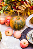 Pumpkins and autumn leaves Stock Images