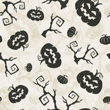 Pumpkins background. Halloween seamless pattern with pumpkins and tree brunches Stock Image