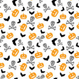 Pumpkins, bats and skull Stock Photos
