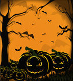 Pumpkins, bats and spiders. On the orange Halloween background Royalty Free Stock Image