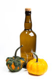Pumpkins and bottle Royalty Free Stock Images