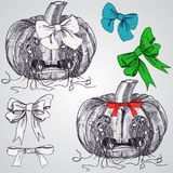 Pumpkins with bows .seeds dropped out through the eyes. Halloween pumkins Stock Photo