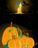 Pumpkins and burning candles Royalty Free Stock Photography