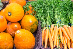 Pumpkins and carrots for sale Royalty Free Stock Images