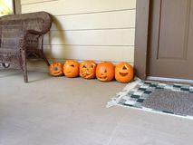 Pumpkins. Carved on porch next to door Stock Images