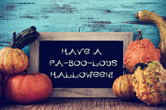 Pumpkins and chalkboard with text have a fa-boo-lous halloween Royalty Free Stock Image