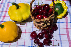 Pumpkins and Cherries Stock Photos
