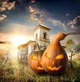 Pumpkins on churchyard Royalty Free Stock Image
