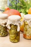 Pumpkins and colorful pickled vegetables in preserving glass Stock Photo