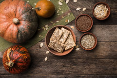 Pumpkins with cookies and seeds on wood in Rustic style. Royalty Free Stock Images