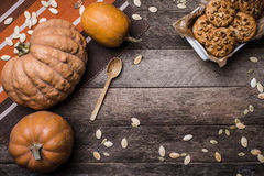 Pumpkins and cookies on wood in Rustic style Royalty Free Stock Photos