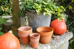 Pumpkins on the coping of a well Royalty Free Stock Image