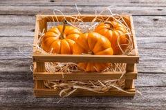 Pumpkins in crate Stock Photo