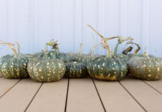 Pumpkins on decking Royalty Free Stock Photography
