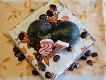 Pumpkins decorating cake. With chestnuts Stock Photos