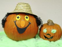 Pumpkins decorations. Two pumpkin heads smiling and a blind little one Royalty Free Stock Photography