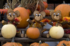 Pumpkins and Dog Wood Carvings Stock Image