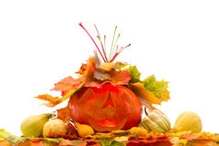 Pumpkins with fall leaves Royalty Free Stock Images