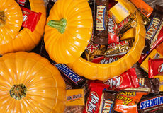 Pumpkins filled with Halloween candy. Decorative pumpkins filled with assorted Halloween chocolate candy stock photo