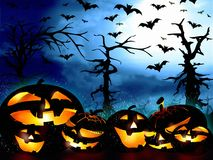 Pumpkins on the forest background and the sky full of bats Royalty Free Stock Photography