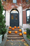 Pumpkins in front of a house in the fall