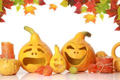 Pumpkins with funny faces on white Royalty Free Stock Photos