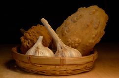 Pumpkins and garlic in a basket Stock Image
