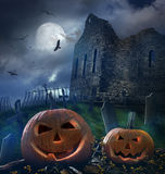 Pumpkins in graveyard  with ruins in background Royalty Free Stock Photography