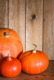 Pumpkins on grunge wooden backdrop background Royalty Free Stock Photo