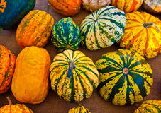Pumpkins for Halloween with funny friends who play with ghosts - Royalty Free Stock Image