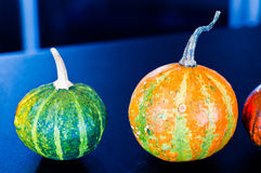 Pumpkins for Halloween with funny friends who play with ghosts - stock illustration